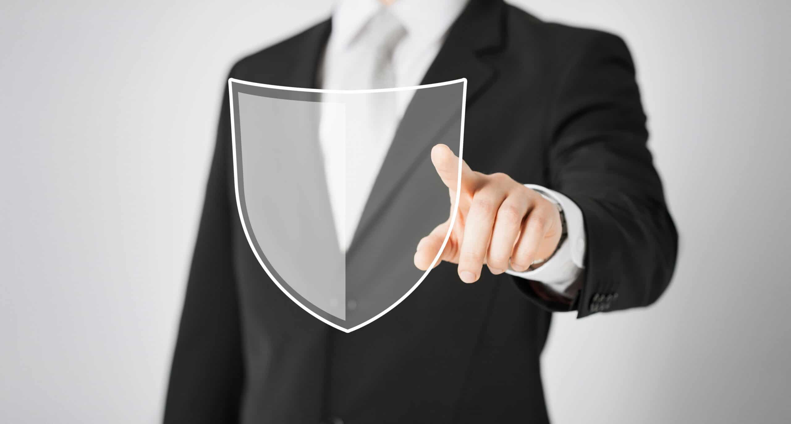 business, people and cyber protection concept - close up of man pointing his finger at virtual antivirus program shield icon over gray background