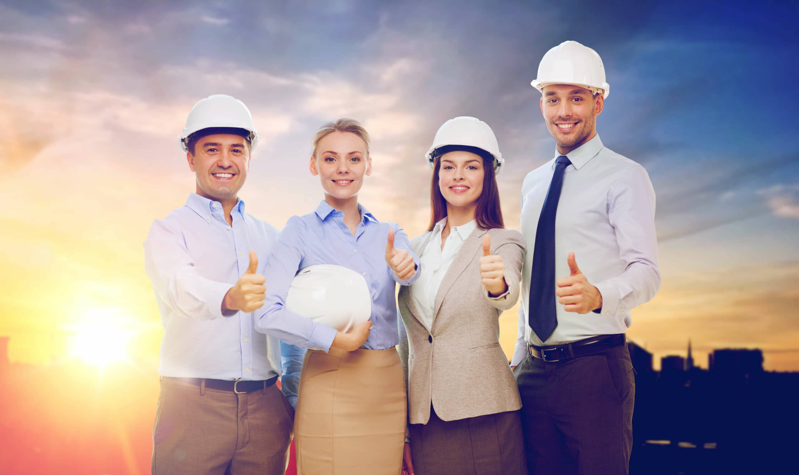 business, architecture and building concept - happy team of architects in white hard hats showing thumbs up over city background